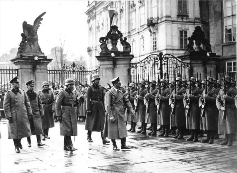 Adolf Hitler reviewing German troops at Prague Castle