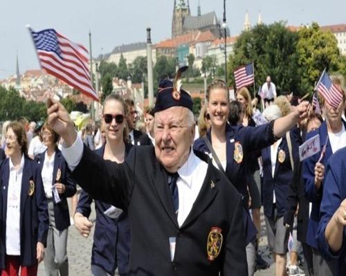 American Sokols in their organization dress uniforms waving flags