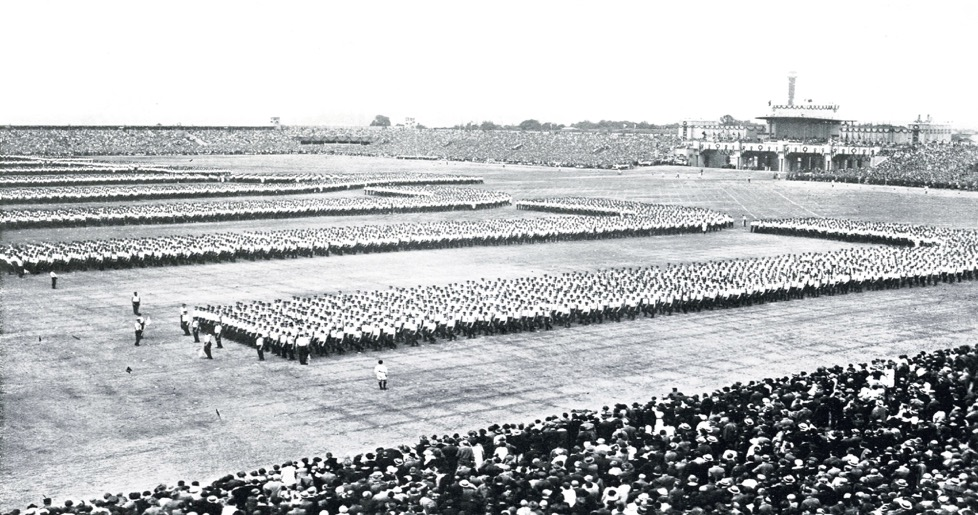 Photo (Czech Union Sokol) shows the men's assembly prior to their mass calisthenics performance.