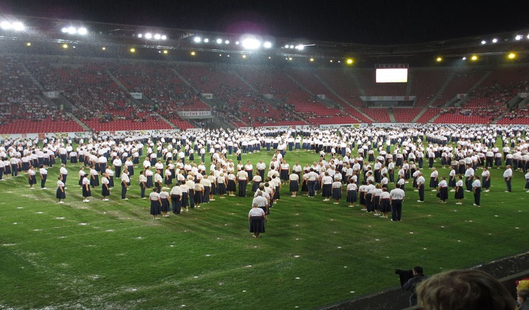 Sokol photo shows senior men and women assembled for mass calisthenic drills at Prague's Eden Stadium