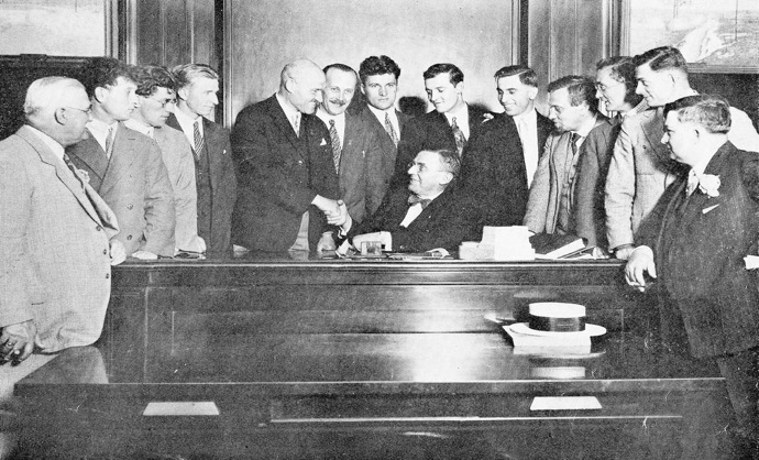 Chicago's Mayor Antonin Cermak, seated in his office, welcomes the Czech Sokol delegation